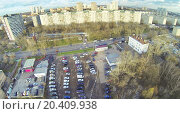 Купить «Cars on parking in residential distric of city. View from unmanned quadrocopter», фото № 20409938, снято 1 ноября 2013 г. (c) Losevsky Pavel / Фотобанк Лори