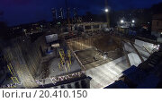 Купить «Night work on construction with crane where workers are building a new house, view from unmanned quadrocopter.», фото № 20410150, снято 8 октября 2013 г. (c) Losevsky Pavel / Фотобанк Лори
