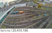 Купить «Tow waggons near the gates of metro depot, view from unmanned quadrocopter.», фото № 20410186, снято 17 октября 2013 г. (c) Losevsky Pavel / Фотобанк Лори