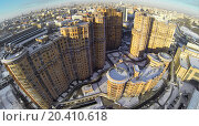 Купить «RUSSIA, MOSCOW - JAN 20, 2014: Aerial view to high-rise residential buildings at Cascade housing complex in winter.», фото № 20410618, снято 20 января 2014 г. (c) Losevsky Pavel / Фотобанк Лори