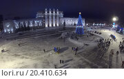 Купить «RUSSIA, SAMARA - JAN 6, 2014: View from unmanned quadrocopter to Kuibyshev Square with christmas tree and people in the evening. Is largest square in Europe.», фото № 20410634, снято 6 января 2014 г. (c) Losevsky Pavel / Фотобанк Лори