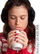 Купить «Young woman drinking a hot drink from a white mug, isolated in a white background», фото № 20428906, снято 17 октября 2012 г. (c) easy Fotostock / Фотобанк Лори