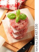 Купить «Pile of raw meat patties on a cutting board», фото № 20437530, снято 12 июня 2011 г. (c) easy Fotostock / Фотобанк Лори
