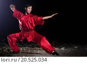 Купить «Shaolin warriors wushoo man in red practice martial art outdoor. Kung fu», фото № 20525034, снято 10 августа 2011 г. (c) easy Fotostock / Фотобанк Лори