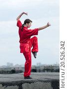 Купить «Shaolin warriors wushoo man in red practice martial art outdoor. Kung fu», фото № 20526242, снято 10 августа 2011 г. (c) easy Fotostock / Фотобанк Лори