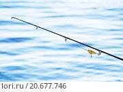 Купить «Удочка с поплавком на фоне воды», фото № 20677746, снято 24 мая 2011 г. (c) Петр Малышев / Фотобанк Лори