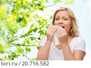 Купить «unhappy woman with paper napkin sneezing», фото № 20716582, снято 27 ноября 2015 г. (c) Syda Productions / Фотобанк Лори