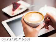 Купить «close up of hands with coffee, tablet pc and cake», фото № 20716638, снято 1 декабря 2015 г. (c) Syda Productions / Фотобанк Лори