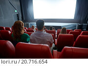 Купить «happy couple watching movie in theater or cinema», фото № 20716654, снято 19 января 2015 г. (c) Syda Productions / Фотобанк Лори