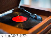 Купить «close up of vintage record player with vinyl disc», фото № 20716774, снято 1 декабря 2015 г. (c) Syda Productions / Фотобанк Лори