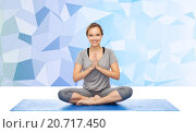 Купить «woman making yoga meditation in lotus pose on mat», фото № 20717450, снято 13 ноября 2015 г. (c) Syda Productions / Фотобанк Лори