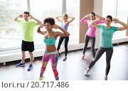 Купить «group of smiling people dancing in gym or studio», фото № 20717486, снято 5 апреля 2015 г. (c) Syda Productions / Фотобанк Лори