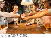 Купить «friends putting hands on top of each other at bar», фото № 20717502, снято 7 мая 2015 г. (c) Syda Productions / Фотобанк Лори