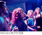 Купить «smiling friends dancing in club», фото № 20717526, снято 20 октября 2014 г. (c) Syda Productions / Фотобанк Лори