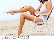 Купить «close up of woman sunbathing in lounge on beach», фото № 20717754, снято 6 августа 2015 г. (c) Syda Productions / Фотобанк Лори