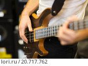 Купить «close up of musician with guitar at music studio», фото № 20717762, снято 11 декабря 2014 г. (c) Syda Productions / Фотобанк Лори