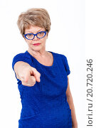 Купить «Женщина со строгим взглядом указывает указательным пальцем в камеру, белый фон», фото № 20720246, снято 13 декабря 2015 г. (c) Кекяляйнен Андрей / Фотобанк Лори