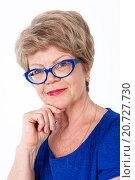 Купить «Портрет улыбающейся пожилой женщины в очках в синей оправе и в платье, крупный план, белый фон», фото № 20727730, снято 13 декабря 2015 г. (c) Кекяляйнен Андрей / Фотобанк Лори