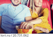 Купить «happy couple watching movie in theater or cinema», фото № 20731062, снято 19 января 2015 г. (c) Syda Productions / Фотобанк Лори