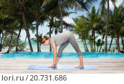 Купить «woman making yoga intense stretch pose on mat», фото № 20731686, снято 13 ноября 2015 г. (c) Syda Productions / Фотобанк Лори