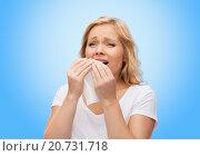 Купить «unhappy woman with paper napkin sneezing», фото № 20731718, снято 27 ноября 2015 г. (c) Syda Productions / Фотобанк Лори