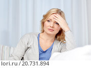 Купить «woman suffering from headache at home», фото № 20731894, снято 27 ноября 2015 г. (c) Syda Productions / Фотобанк Лори