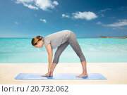 Купить «woman making yoga intense stretch pose on mat», фото № 20732062, снято 13 ноября 2015 г. (c) Syda Productions / Фотобанк Лори
