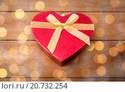 Купить «close up of heart shaped gift box on wood», фото № 20732254, снято 10 декабря 2015 г. (c) Syda Productions / Фотобанк Лори