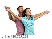 Купить «Cheerful couple with arms outstretched», фото № 20733258, снято 28 мая 2015 г. (c) Wavebreak Media / Фотобанк Лори