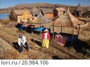 Купить «Aymara people welcoming a boat, Uros Islands, Lake Titicaca, Puno, Peru, South America.», фото № 20984106, снято 17 июня 2015 г. (c) age Fotostock / Фотобанк Лори