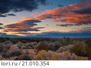 Купить «Storm clouds at sunrise over the Honey Valley, near Susanville, Lassen County, California.», фото № 21010354, снято 6 ноября 2009 г. (c) age Fotostock / Фотобанк Лори