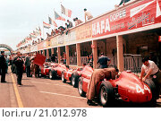 Купить «Phil Hill with Leica camera on left, Ferrari D50s Pits, French GP Reims 1 July 1956», фото № 21012978, снято 20 августа 2015 г. (c) age Fotostock / Фотобанк Лори