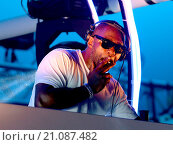 Купить «Idris Elba smokes a hand-rolled cigarette while playing a DJ set at the Goodwood Racecourse in West Sussex, at the last of their 'Three Friday Nights'...», фото № 21087482, снято 19 июня 2015 г. (c) age Fotostock / Фотобанк Лори
