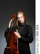 Купить «Woman playing classical cello in music concept», фото № 21088994, снято 20 сентября 2015 г. (c) Elnur / Фотобанк Лори