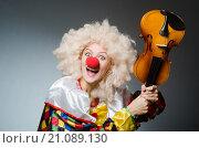Купить «Clown in funny concept on dark background», фото № 21089130, снято 4 октября 2015 г. (c) Elnur / Фотобанк Лори