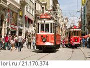 Купить «Vintage tram on the Istiklal Street in Istanbul, Turkey. Nostalgic tram of Istanbul is the heritage tramway system. It was re-established in 1990.», фото № 21170374, снято 15 мая 2015 г. (c) Наталья Волкова / Фотобанк Лори