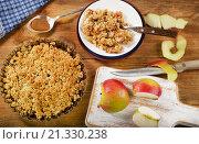 Купить «Apple Crumble Dessert on rustic wooden board.», фото № 21330238, снято 11 декабря 2015 г. (c) Tatjana Baibakova / Фотобанк Лори
