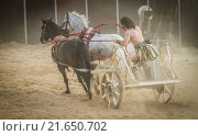 Купить «Games of thrones, chariot race in a Roman circus, gladiators and slaves fighting», фото № 21650702, снято 17 октября 2019 г. (c) easy Fotostock / Фотобанк Лори
