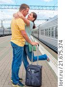 Купить «Встреча. Молодая пара стоит обнявшись на перроне между поездами», фото № 21675374, снято 2 августа 2015 г. (c) Константин Лабунский / Фотобанк Лори