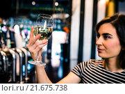 Купить «Attractive woman looking at her glass of wine», фото № 21675738, снято 25 сентября 2015 г. (c) Wavebreak Media / Фотобанк Лори