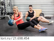 Купить «Fit couple doing abdominal ball exercise», фото № 21698454, снято 18 сентября 2015 г. (c) Wavebreak Media / Фотобанк Лори