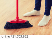 Купить «close up of woman legs with broom sweeping floor», фото № 21703862, снято 18 февраля 2015 г. (c) Syda Productions / Фотобанк Лори