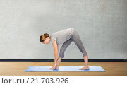 Купить «woman making yoga intense stretch pose on mat», фото № 21703926, снято 13 ноября 2015 г. (c) Syda Productions / Фотобанк Лори
