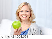 Купить «happy middle aged woman with green apple at home», фото № 21704658, снято 27 ноября 2015 г. (c) Syda Productions / Фотобанк Лори