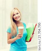 Купить «smiling student with folders», фото № 21704790, снято 30 марта 2013 г. (c) Syda Productions / Фотобанк Лори