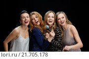 Купить «happy young women with microphone singing karaoke», фото № 21705178, снято 21 ноября 2015 г. (c) Syda Productions / Фотобанк Лори