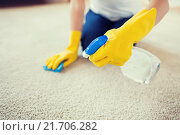 close up of woman with cloth cleaning carpet. Стоковое фото, фотограф Syda Productions / Фотобанк Лори