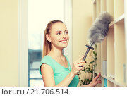 Купить «happy woman with duster cleaning at home», фото № 21706514, снято 25 января 2015 г. (c) Syda Productions / Фотобанк Лори