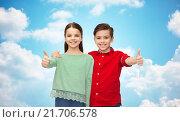 Купить «happy boy and girl showing thumbs up», фото № 21706578, снято 9 января 2016 г. (c) Syda Productions / Фотобанк Лори