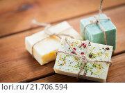 Купить «close up of handmade soap bars on wood», фото № 21706594, снято 21 декабря 2015 г. (c) Syda Productions / Фотобанк Лори